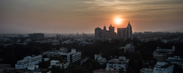 The sun setting behind the city of Bangalore's skyline.