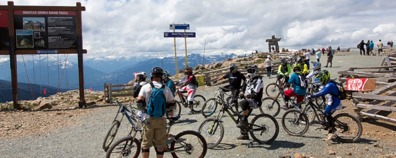 Several bicyclists on the top of Whistler Mountain in Canada.