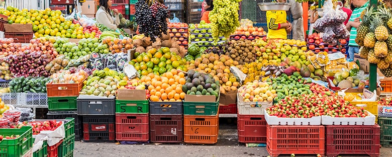 Fruits hanging from a stand at the Paloquemao Market in Bogota, Colombia.