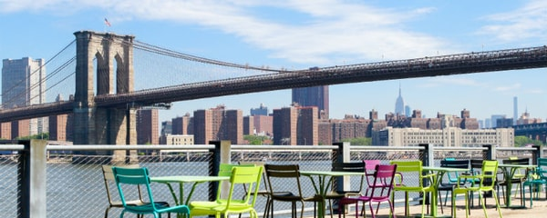 A view of the Brooklyn Bridge on a sunny day.