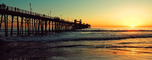 Classic California beach boardwalk seen at sunset