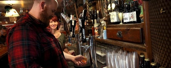 Lagunitas beer being poured by a bartender at a California brewery.
