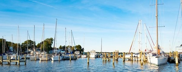 Sailboats docked at a Chesapeake Bay marina in Virginia.