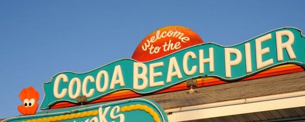 A sign for the Cocoa Beach Pier in Orlando.