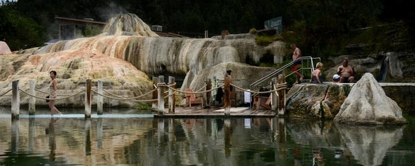 A group of people hanging out as a hot spring in Colorado.