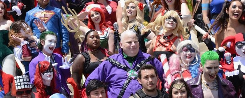 Cosplay enthusiasts standing next to each other dressed up at a Comic-Con event in San Diego.