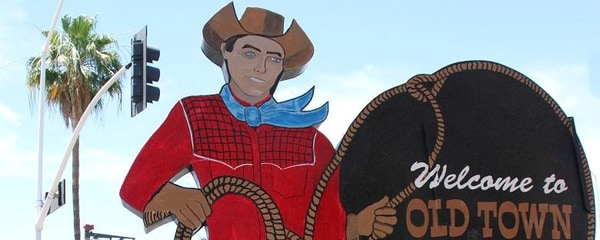 A cowboy shaped sign for Old Town Scottsdale in Arizona.