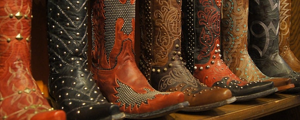 Close up view of embellished cowboy boots on a shelf in Dallas, Texas.