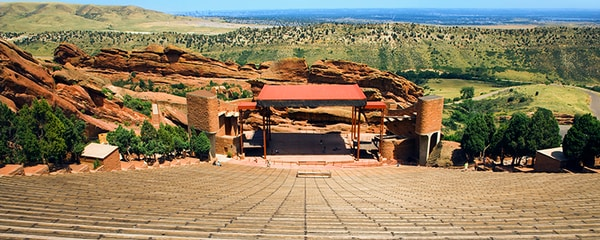 Long shot view of Red Rocks Amphitheater on a sunny day.
