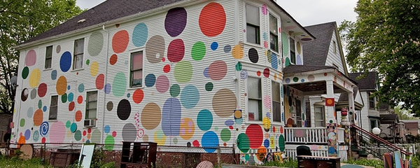 A house in Detroit painted with a lot of color and designs.