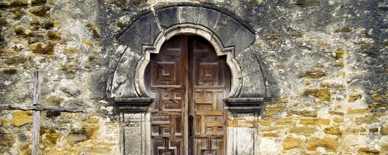 Cropped view of the doorway to Mission Espada in San Antonio.