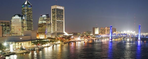 Downtown Jacksonville illuminated at night.