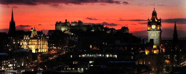 A castle in Edinburgh during sunset.