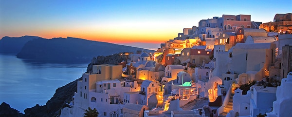 Full view of Oia, Santorini, as the sun is setting with magnificent colors.