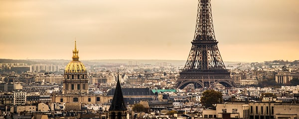 The Eiffel Tower rises up from the iconic city of Paris, France