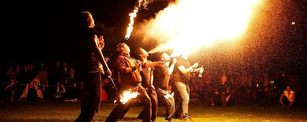 A group of fire breathers performing during a festival in Chicago.