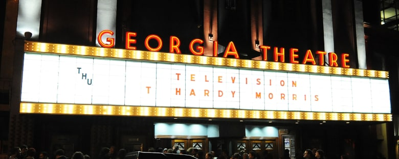 The Georgia Theatre sign lit up during a night show in Athens.