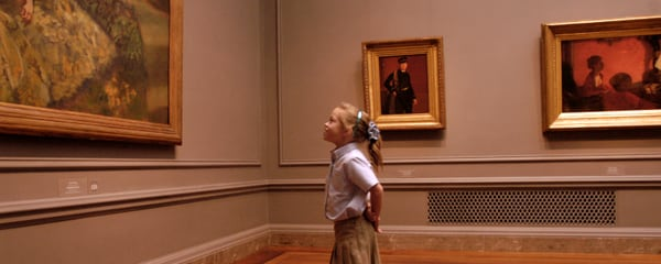 A young girl looking at a piece of art at a museum in Washington, DC.