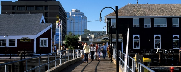 People walking by the harbor in Halifax, Canada.