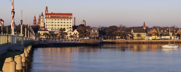St. Augustine's pier over the water leading to its historic buildings.