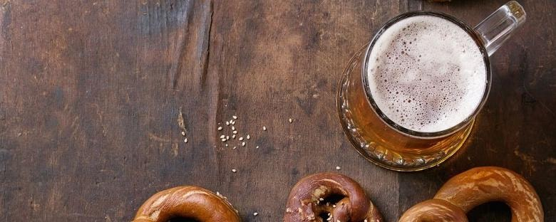 Soft pretzels served with a full glass of beer at a brewery in Indianapolis.