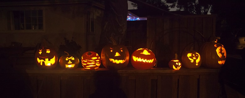 A Halloween night in Newport Beach with lit up pumpkins.
