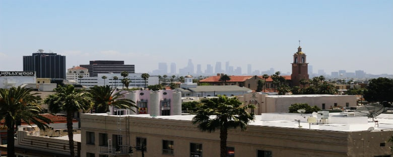 A view of the Los Angeles skyline from a far on a sunny day.