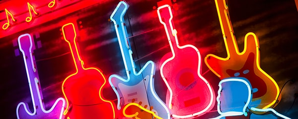 Close up view of illuminated colorful guitars on Beale Street in Memphis.