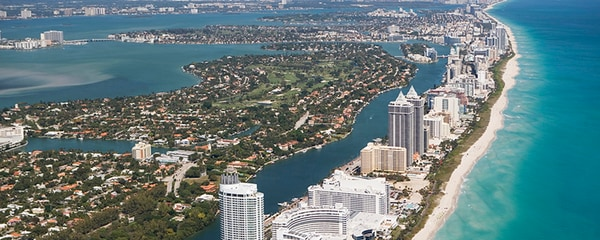 Aerial view of Miami's shoreline on a sunny day.
