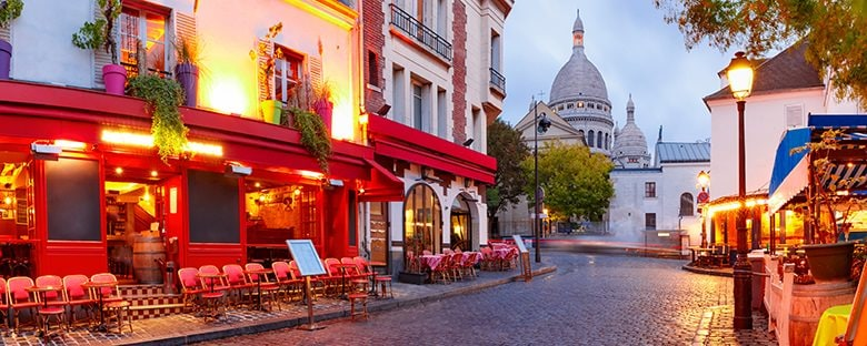The streets of Montmarte in Paris, France at night.