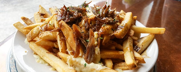 Montreal's famous dish, duck poutine.
