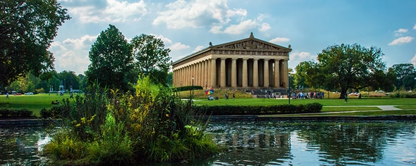 The Parthenon at Centennial Park in Nashville, Tennessee reflecting off the pond.
