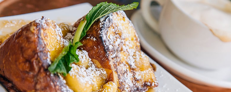 French toast and coffee served for brunch in News Orleans.