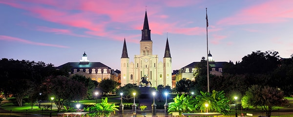 The Saint Louis Cathedral in New Orleans at night.