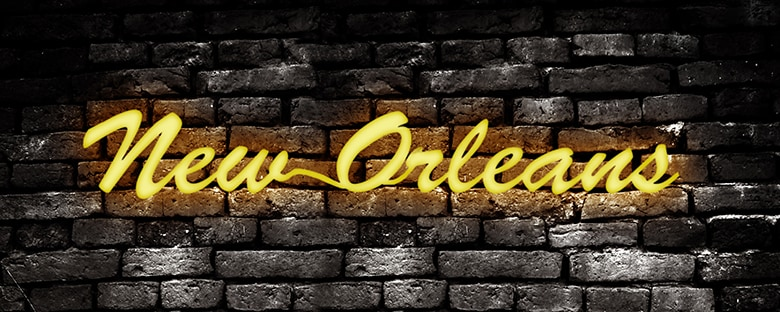 "A yellow neon sign that reads ""New Orleans""."