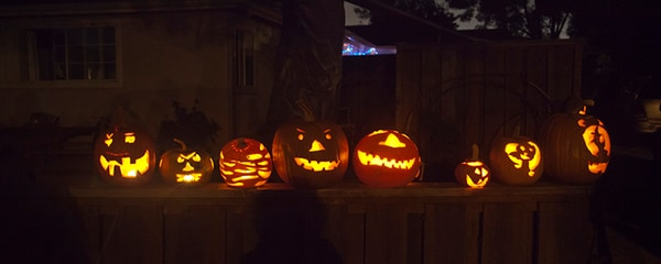 Carved pumpkins lined up on Halloween in Newport Beach.
