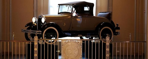 An old model of a Ford is on display at the Art Deco Building in Chicago.