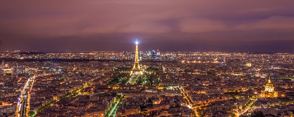 The Eiffel Tower and the rest of the City of Lights glow at night in Paris, France