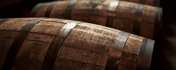 A row of bourbon barrels in Kentucky.