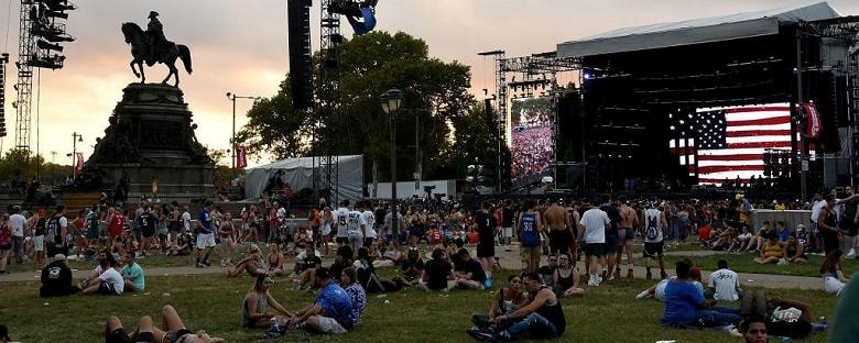 Eye level view of fans sitting on the lawn at the Made in America Festival in Philadelphia.