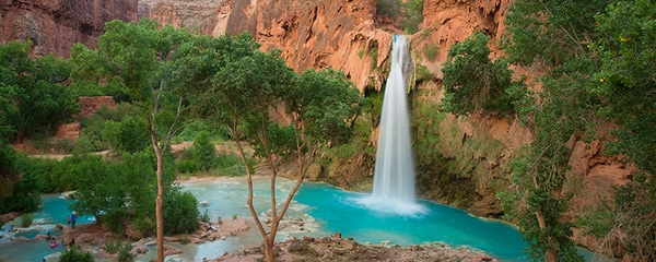 The clear blue water of Havasu Falls flowing at sunset in Havasupai.