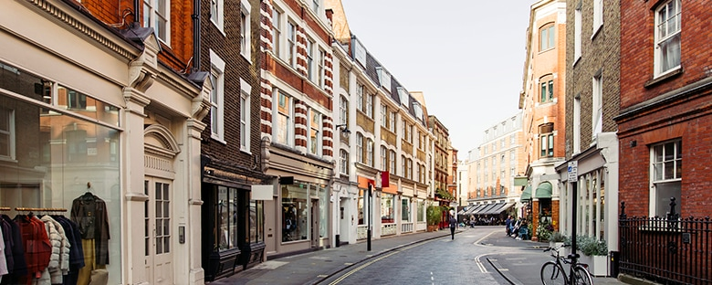 A quiet London street lined with boutiques and shops.