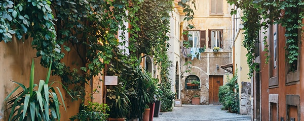 Romantic apartments in Rome along a lush street