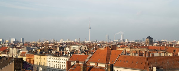 Rooftop view of Berlin with the city in the background.