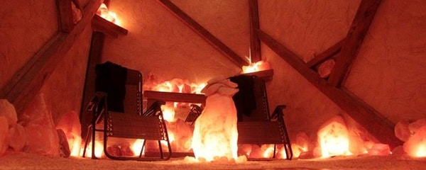 Angled view from inside a therapeutic salt cave with an orange hue in Chicago.