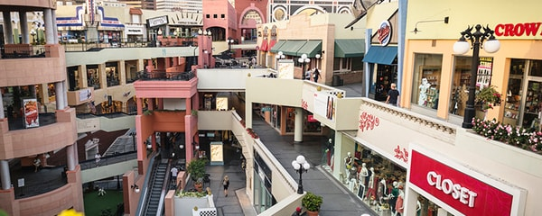 A shopping mall in San Diego with several colorful stores.