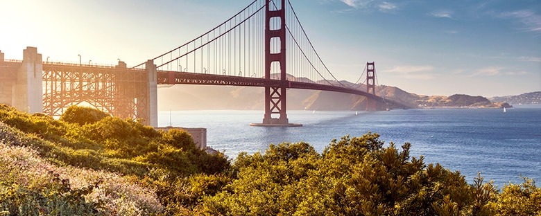 San Francisco's Golden Gate Bridge glowing on a sunny day.