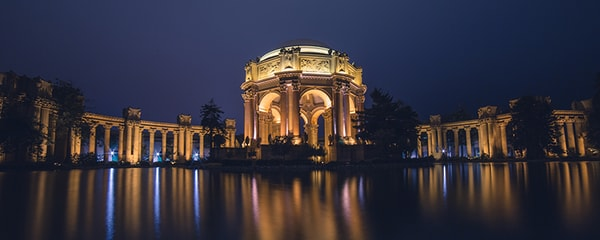 The Palace of Fine Arts in San Francisco illuminated at night.