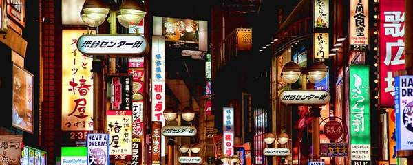 A cluster of multi-coloured signs crowd the streets in Tokyo, Japan