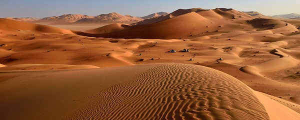 Long shot view of sand dunes in the Rub al Khali desert in UAE.